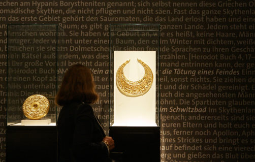 "A visitor walks through the exhibition ""Royal Tombs of the Scythes"" in the Martin Gropius Bau Museum in Berlin, July 4, 2007. The exhibition is open to the public from July 6 to Oct. 1, 2007. (AP Photo/Franka Bruns)"