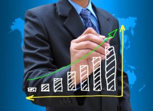 photodune-1699487-businessman-hand-drawing-business-graph-m6