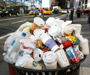 A garbage bin sits full after the Macy's Thanksgiving Day Parade in New York November 22, 2012.   REUTERS/Carlo Allegri  (UNITED STATES - Tags: SOCIETY ENTERTAINMENT) - RTR3AQV8